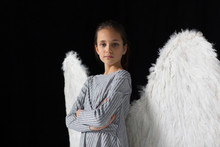 Portrait Confident, Brave Girl Wearing Angel Wings