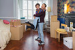 Portrait happy, playful couple moving into new house