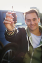 Portrait Happy Young Man Holding New Car Keys With Heart-shape Key Chain
