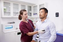 Female Nurse Using Stethoscope...