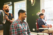 Male Barber Holding Mirror For...