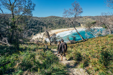 Men Hiking On Path To Sunny Remote Ocean Beach Jervis Bay Australia