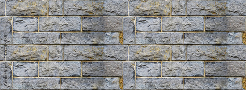 Photo Sturdy blue and gray cut stone wall, seamless lined up
