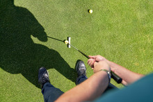 Point Of View Man Putting Golf...