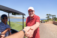 Personal Perspective Male Golfers Handshaking On Sunny Golf Course