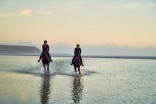 Young Women Horseback Riding I...