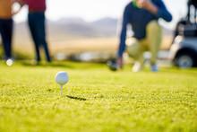 Golf Ball On Tee In Grass On Sunny Tee Box