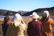 Senior Friends On Safari Watching Zebras In Distance South Africa