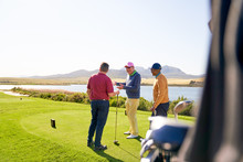 Male Golfers Talking At Tee Bo...