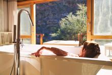Serene Woman Taking A Bath In Sunny Hotel Room