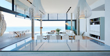 Modern Luxury Living Room Open To Patio With Ocean View