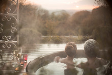 Serene Couple In Hot Tub Looki...