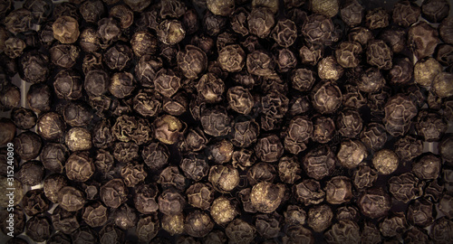 Black pepper seeds in full screen. Canvas-taulu