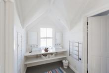 Luxury White Bathroom Sinks In Bathroom With Vaulted Ceiling