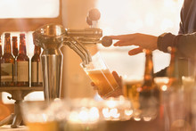 Bartender Pouring Beer From Be...