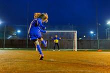 Girl Soccer Player Kicking The...