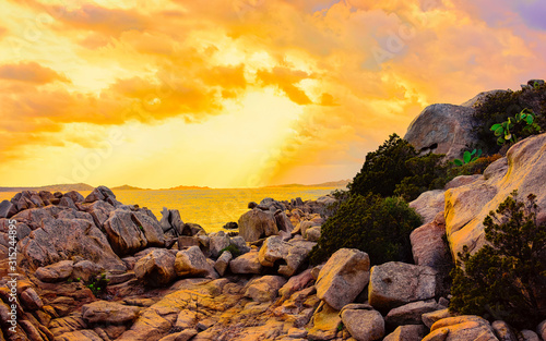 obraz lub plakat Landscape with Romantic sunset at Capriccioli Beach in Costa Smeralda of the Mediterranean sea on Sardinia island in Italy. Sky with clouds. Porto Cervo and Olbia province. Mixed media.