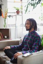 Serene Young Man Meditating Wi...