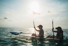 Women In Clear Bottom Canoe On...