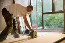 Construction Worker Using Elec...