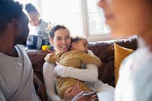 Happy Mother Cuddling Baby Son...