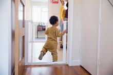 Cute Baby Boy Balancing In Doo...