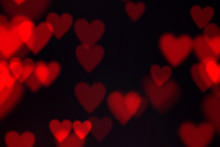Red Color Heart Shape Bokeh Effect On Black Background. Valentine's Day Background