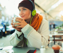 Young Woman With Headphones Li...