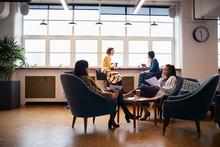 Businesswomen Talking In Open ...