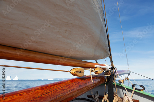 Wooden sailboat mast on sunny arctic ocean Atlantic Ocean Greenland - 315250046