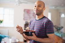 Portrait Confident Man Eating