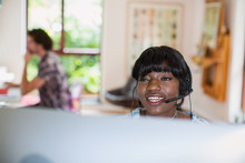 Young Woman With Headset Worki...