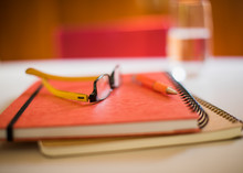 Close Up Notebooks Eyeglasses And Pen