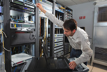 Network Engineer Configuring Data Switch