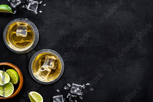 Bar background with whiskey and ice on black desk top-down frame copy space Canvas Print