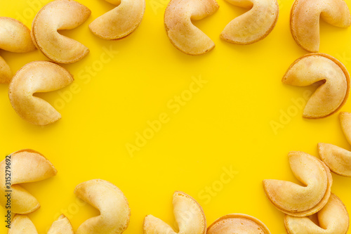 Fortune cookie frame on yellow background top-down copy space Wallpaper Mural