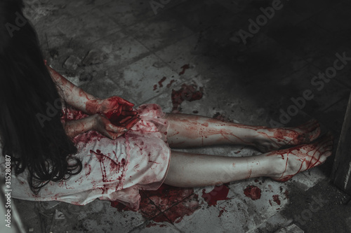 Fototapeta White dress woman was killed with bloodstain, Depression and sadness