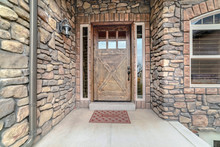 Entrance Door To Home With Stone Brick Walls