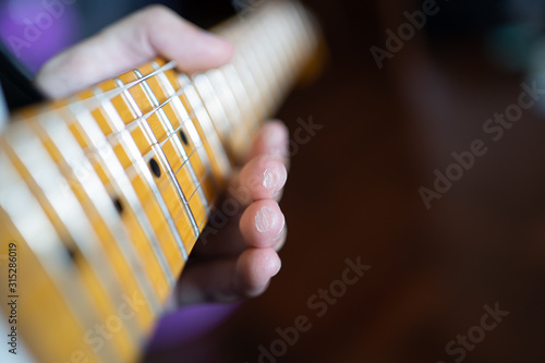 Guitarist got calluses, the hardened skin, on the finger by playing guitar Fototapet