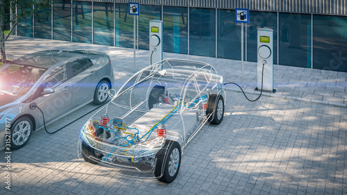 Fotografia generic electric car with battery visible x-ray charging at public charger in ci