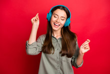 Photo Of Pretty Lady Cheerful Mood Modern Technology Headphones On Ears Listen New Popular Youth Song Wear Casual Grey Green Shirt Isolated Red Color Background