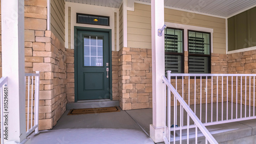 Fototapeta Panorama Snow covered front steps and porch day light obraz