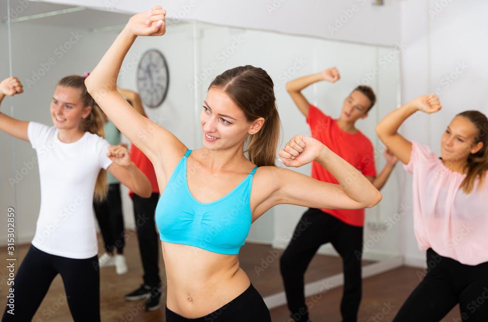 Fototapeta Female coach training dance with teenagers