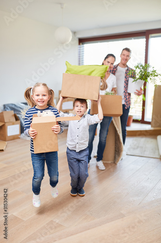 Parents and children enjoy the move #315304242