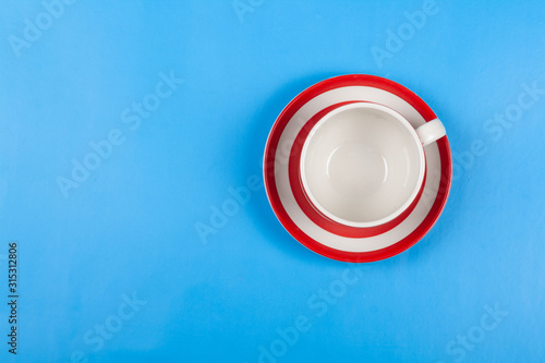 Empty cup for tea on a blue background Top view Tablou Canvas