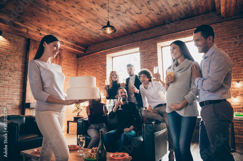 Obraz Photo of best friends meeting married couple waiting baby born arranging surprise baby party holding big cake wear formalwear restaurant room indoors - fototapety do salonu