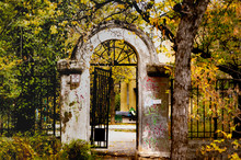 Old White Arch With A Rickety Wicket On A Background Of Autumn