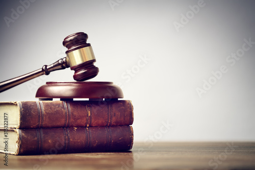 Judge gavel and law books in court background with copy space