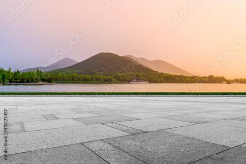 Obraz Empty Plaza Floor Bricks and Beautiful Natural Landscape - fototapety do salonu
