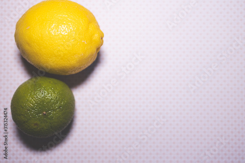 lime and lemon fruit on background